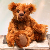 Timothy Tucker is a very sweet and charming, one of a kind artist teddy bear by Barbara Ann Bears in gorgeous English mohair, like a young bear cub. He stands 10.5 inches/26 cm tall and is 8 inches/20 cm sitting. Timothy Tucker is made from a beautiful, dense, distressed, warm cinnamon coloured English mohair