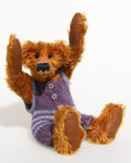 Tom Barleycorn is a mohair teddy bear in a swimsuit by Barbara Ann Bears