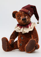 The Frederick Teddy Bear pattern makes a sweet traditional Barbara-Ann Bear about 15 inches (38cm) tall. This one in mahogany vintage mohair and with a clown hat and lace collar