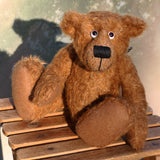 Tommy Tickle is an extremely happy, cute and friendly one of a kind mohair artist bear by Barbara Ann Bears, he stands 9.5 inches(24 cm) tall and is 7.5 inches (19 cm) sitting. Tommy Tickle is made from a medium length, wildly tousled brown German mohair with brown German wool felt paw pads, googly eyes and a big smile