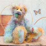 Theodore Tonks is a very handsome and colourful, one of a kind, mohair artist bear by Barbara-Ann Bears, he stands 17 inches(43 cm) tall and is 13 inches(33 cm) sitting.  Theodore Tonks is made from a long and twirly kid mohair that Barbara has dyed in gorgeous shades of green, blue, turquoise, peach, gold and lilac