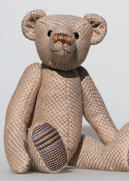 Tweedy is a an elegant and refined traditional Barbara Ann Bear made in a very dapper tweed from our local tweed maker Romney Tweed  Tweedy is 16 inches (38cm) tall and is 11 inches (30cm) sitting.  Tweedy is a collaboration with our local tweed maker Romney Tweed. He is an elegant, classical teddy bear, a refined gent, charming and whimsical, like a bear in a tweed suit.