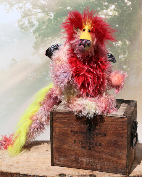 Twinkle a wild, fun loving and happy dragon in gorgeous, colourful hand-dyed mohair and faux fur by Barbara Ann Bears  Twinkle stands 13 inches (33 cm) tall and is 10 inches (25 cm) sitting. Twinkle is about 33 inches (84 cm) from nose to tail and has a wingspan of 14 inches (36 cm).