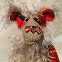 Wallace is a very handsome and dignified, one of a kind, artist bear by Barbara-Ann Bears, he stands 16 inches(41 cm) tall and is 12 inches(30 cm) sitting. He is made from the Wallace tartan coupled with a long, fluffy greyish-beige mohair which forms his face, tummy, the backs of his ears and the underside of his tail