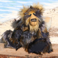 Walter Klondike is a shaggy, wild and wonderful, one of a kind, artist teddy bear by Barbara-Ann Bears. He's made from long shaggy dense faux fur which is navy blue at the base with gold, ice blue and black tipping. Moritz is a large and heavy teddy bear, he stands 19 inches (48 cm) tall and 14.5 inches (38 cm) sitting