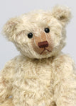 Warburton is a very sweet and loving classical, traditional mohair artist teddy bear by Barbara Ann Bears, he is 17 inches (43cm) tall and is 13 inches (33cm) sitting. Warburton is made from distressed creamy white mohair with beige wool felt paw pads, reproduction black boot button eyes and an embroidered brown nose