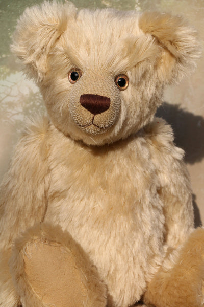 Willoughby is a sweet and cuddly, traditional one of a kind, artist teddy bear made in splendid German mohair by Barbara Ann Bears, he stands 18.5 inches (47cm) tall and is 13.5 inches (34cm) sitting. He is made from dense, blond, straight pile, German mohair with beige wool-felt paw pads & hand painted beautiful eyes