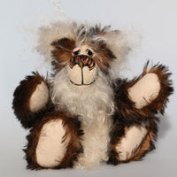 Woody is a very friendly and cuddly one of a kind, artist bear by Barbara-Ann Bears in wonderful fluffy tipped mohair Woody stands 9 inches(23 cm) tall and is 7 inches(18 cm) sitting.   Woody is a very happy and cuddly teddy bear. He's so fluffy that he could almost trip over his own fur