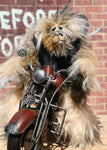 Wild Wyatt is a wild, freakishly fast and surprisingly friendly, one of a kind, mohair, artist,  biker bear by Barbara-Ann Bears. He is 11.5 inches (29 cm) tall sitting on his bike, sitting without a bike he is 10 inches (25 cm) tall and his model Indian Chief bike is 14.5 inches (36 cm) long.