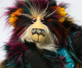 Yolaf Yeti-Boogie, an exceedingly vibrant, happy and colourful, one of a kind, artist yeti-bear in faux fur & mohair by Barbara-Ann Bears Yolaf Yeti-Boogie stands 13.5 inches (34 cm) tall and is 11 inches (28 cm) sitting.