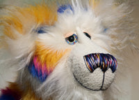 Zebedee has large, beautiful, hand painted glass eyes with hand coloured eyelids, he has a carefully embroidered nose that incorporates all of his colours and a sweet, thoughtful smile