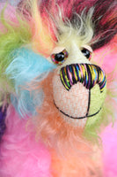 Zoiks! is a rather colourful and comical one of a kind artist bear in beautiful, fluffy hand dyed mohair and faux fur by Barbara Ann Bears. Zoiks! stands 10.5 inches( 33 cm) tall and is 8 inches (20 cm) sitting, this doesn't include his plumes of hair which add another 3 inches/ 7.5cm.