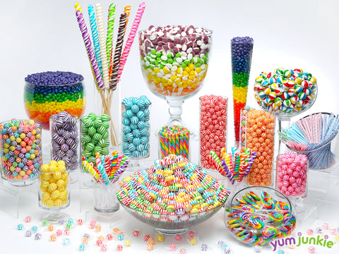 Rainbow candy buffet featuring candy by color from YumJunkie!