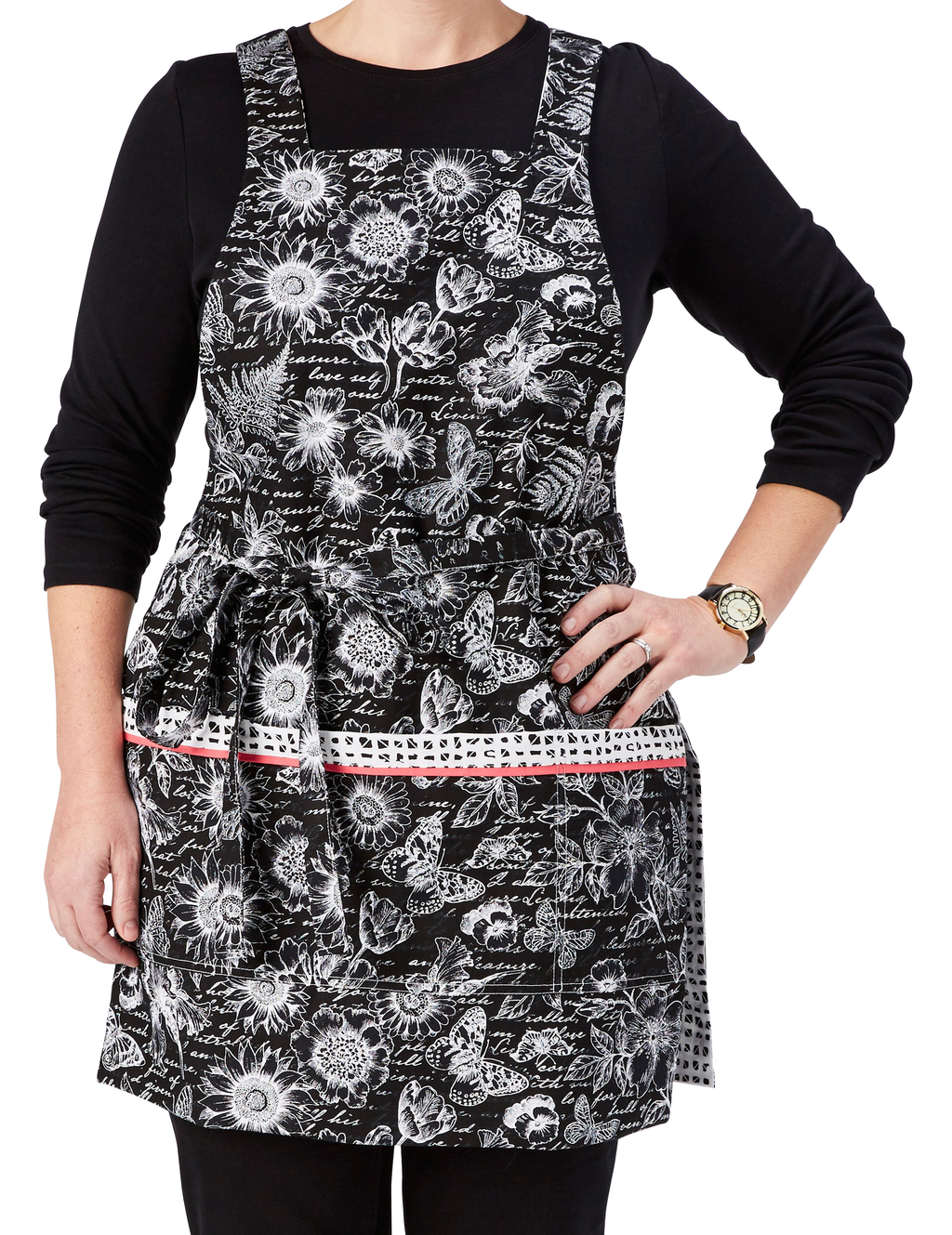 This stylish apron features a timeless black and white garden journal print apron reversing to a black and white pattern of miniature blocks, garden journal print side, front view.