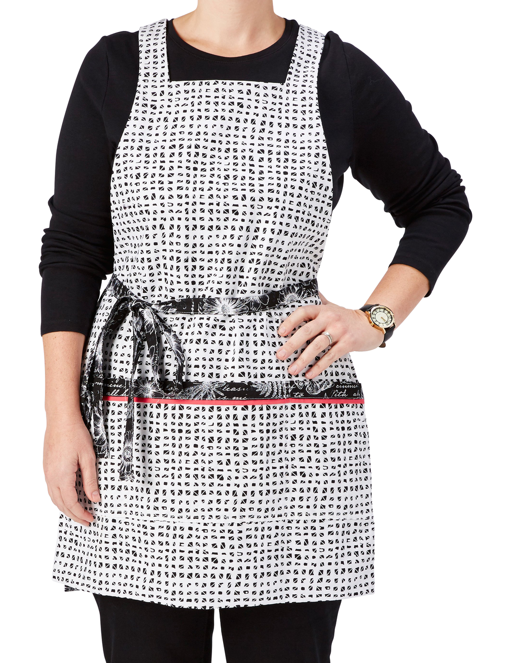 This stylish apron features a timeless black and white garden journal print apron reversing to a black and white pattern of miniature blocks, miniature blocks print side, front view.