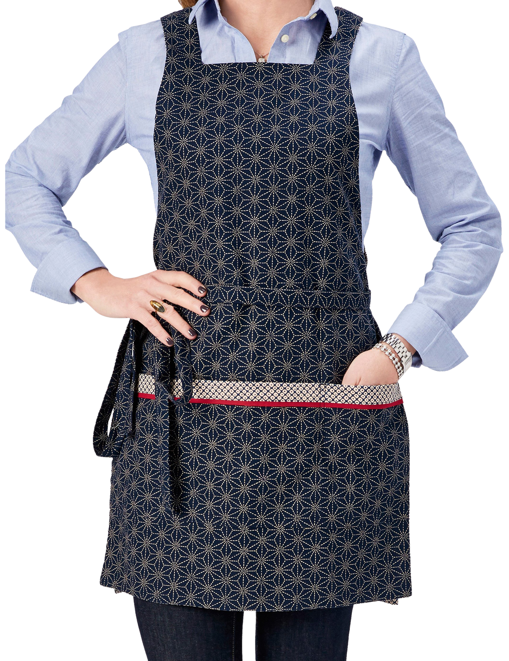 Japanese apron in a Kasuri-inspired print of stitched stars on one side reversing to an ikat dot print on the other in navy and ivory, star print side, front view.