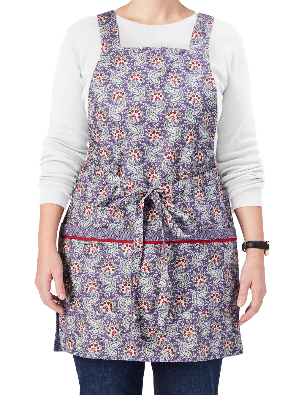 Vintage pinafore style reversible apron in paisley print. Dusty purple with red and ivory accents. Front View