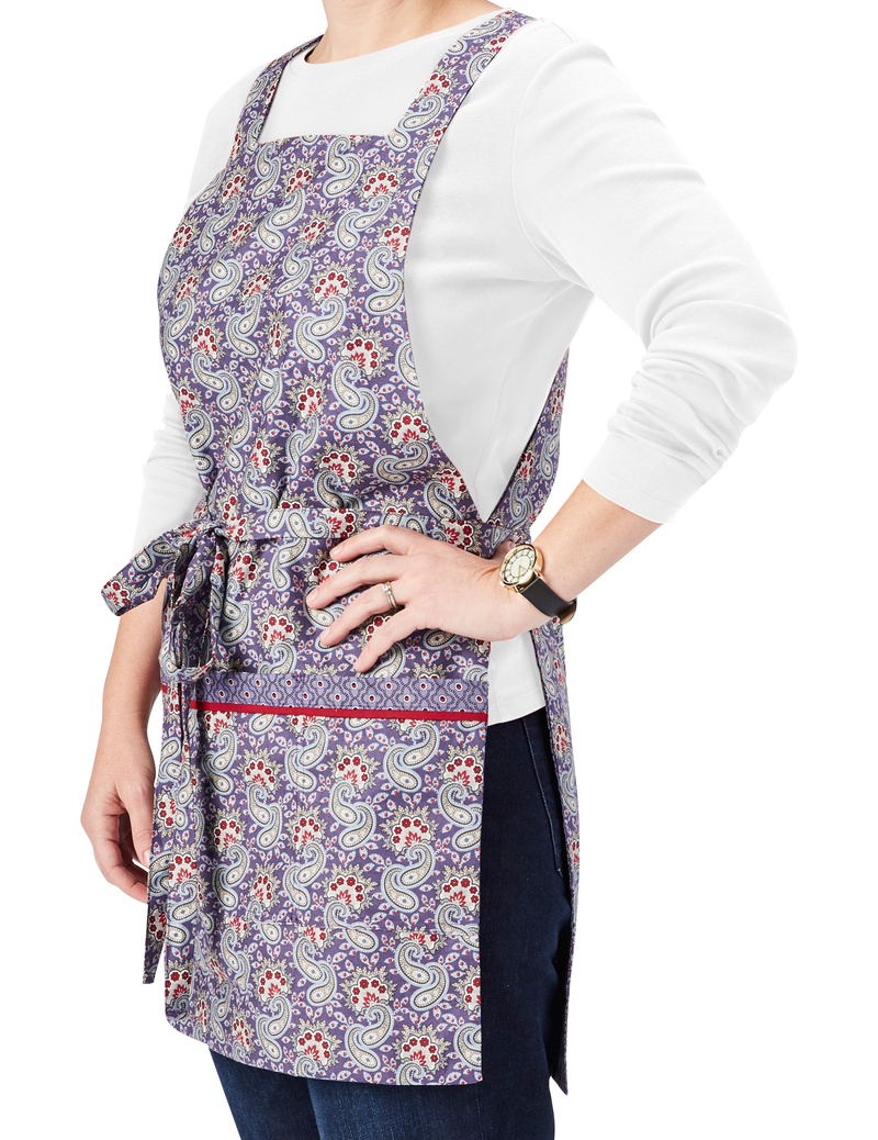 Vintage pinafore style reversible apron in paisley print. Dusty purple with red and ivory accents. Side View