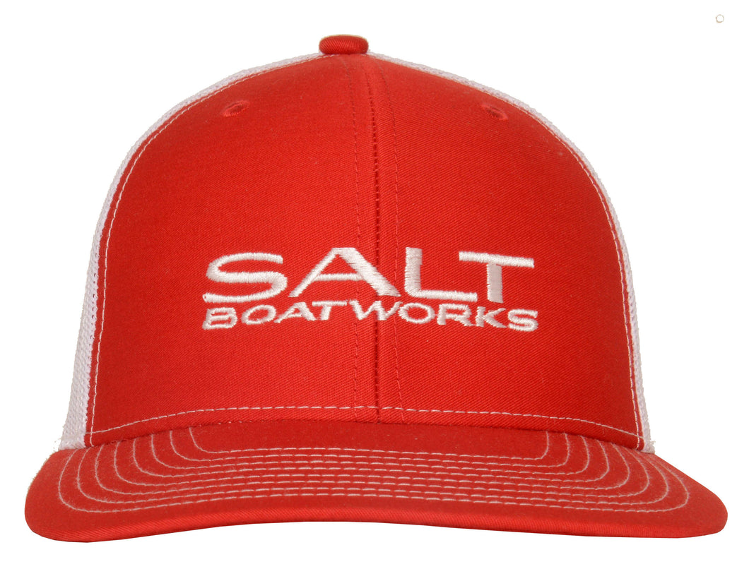 Salt Boatworks white logo on red trucker hat with white mesh