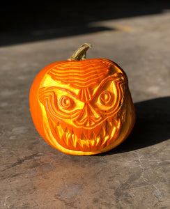A Pumpkin With Intricate Designs Created With The Pumpkin Carving Tools