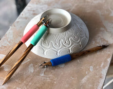 Detailed pottery piece designed with fine point clay carving tools