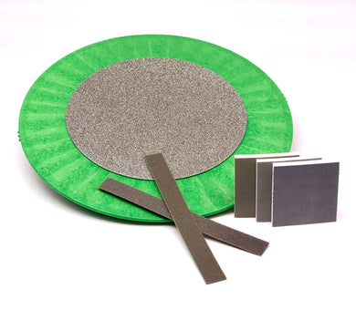 "This assortment covers the gamut for all your grinding and sanding needs!  Included is one each 400 grit, 800 grit, and 1500 grit square corner flexible sanding pad, one each 120 grit and 240 grit sanding strip, and one 60"" diamond grinding disc permanently affixed to a rigid plastic bat.  Kit price is $189, regular retail if purchased separately is $218.  That's a $29 savings!"
