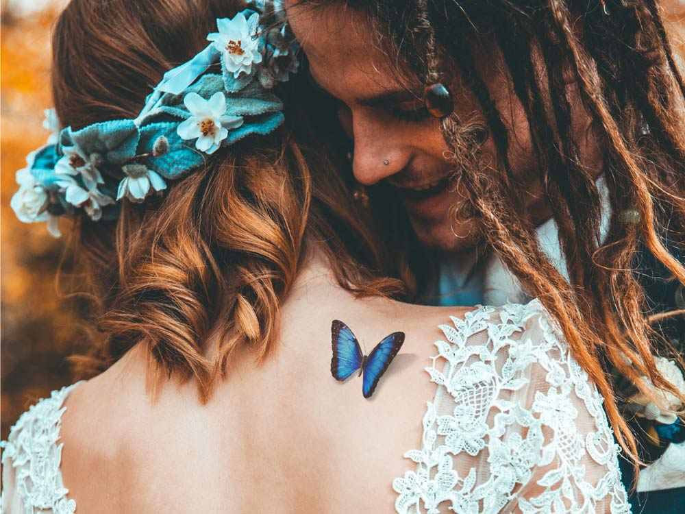 Realistic 3D shadow blue morpho butterfly romantic and elegant temporary tattoo on woman's back or shoulder