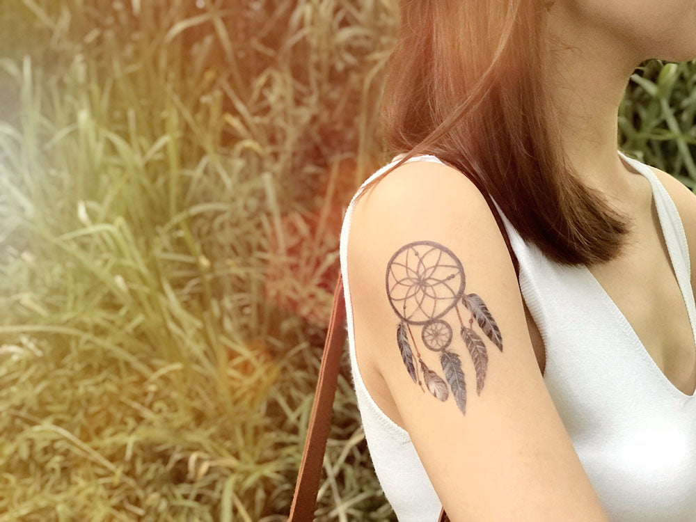 Tribal dreamcatcher designer temporary tattoo on arm in navy and teal for bohemian, wild look Singapore.