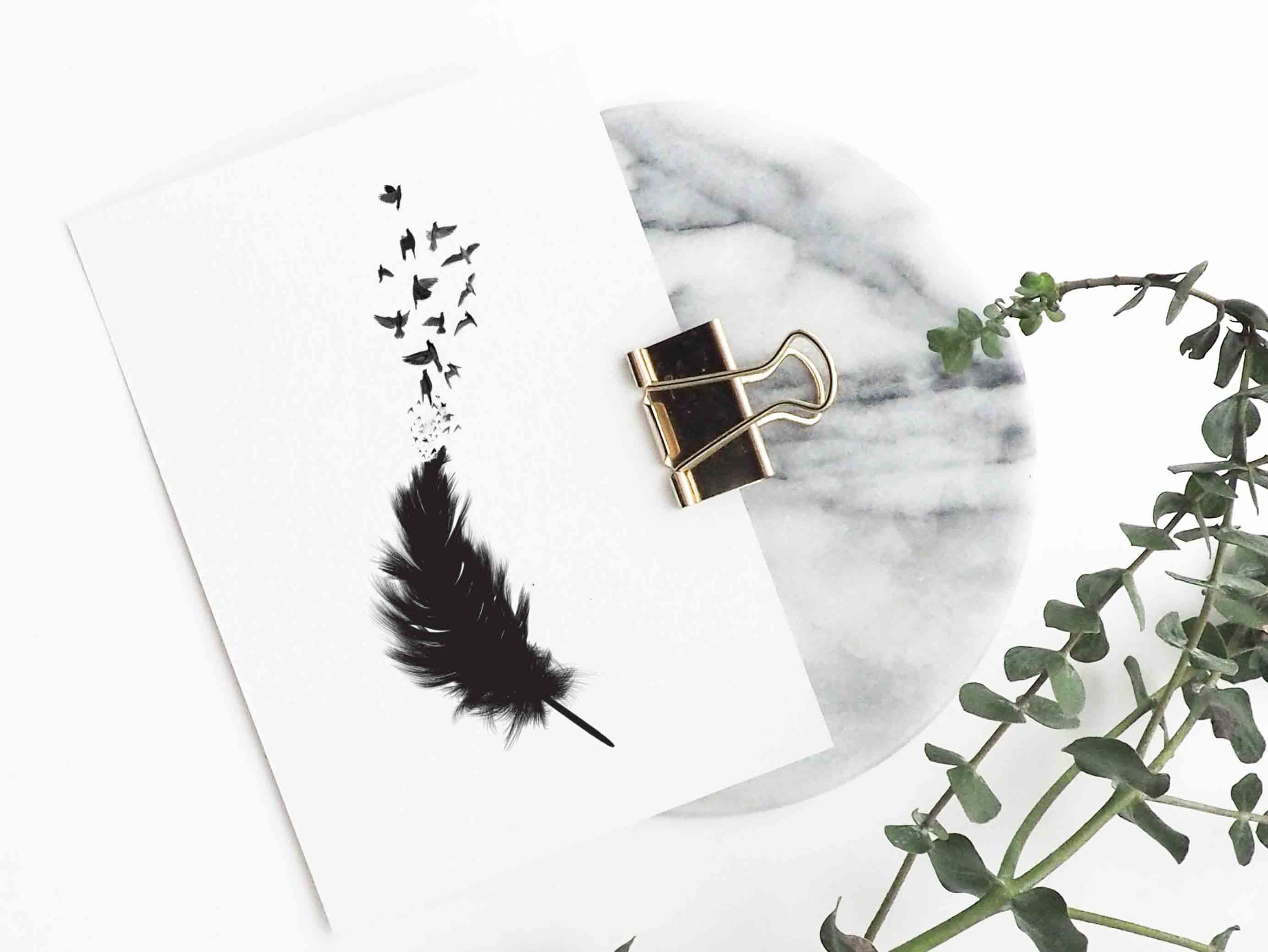 Birds flocking from a feather in black silhouette designer temporary tattoo