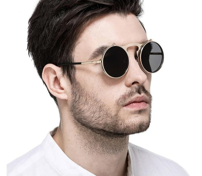 Calanovella Steampunk Round Sunglasses Cool Oval Round Flip Up Sunglasses for Men Women 2020 Steampunk Goggles Flipup Lenses Trendy Men's Women's Gothic Metal Frame Oval Round Clip on Sun Glasses UV400 black gray,gold gray,silver gray,silver,silver blue,silver green,rose gold gray 34.99 USD