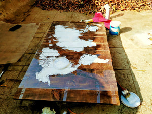 Pravin charts the world on a rustic board
