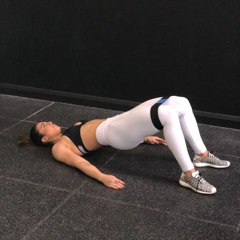 Bodyweight glute bridge with band