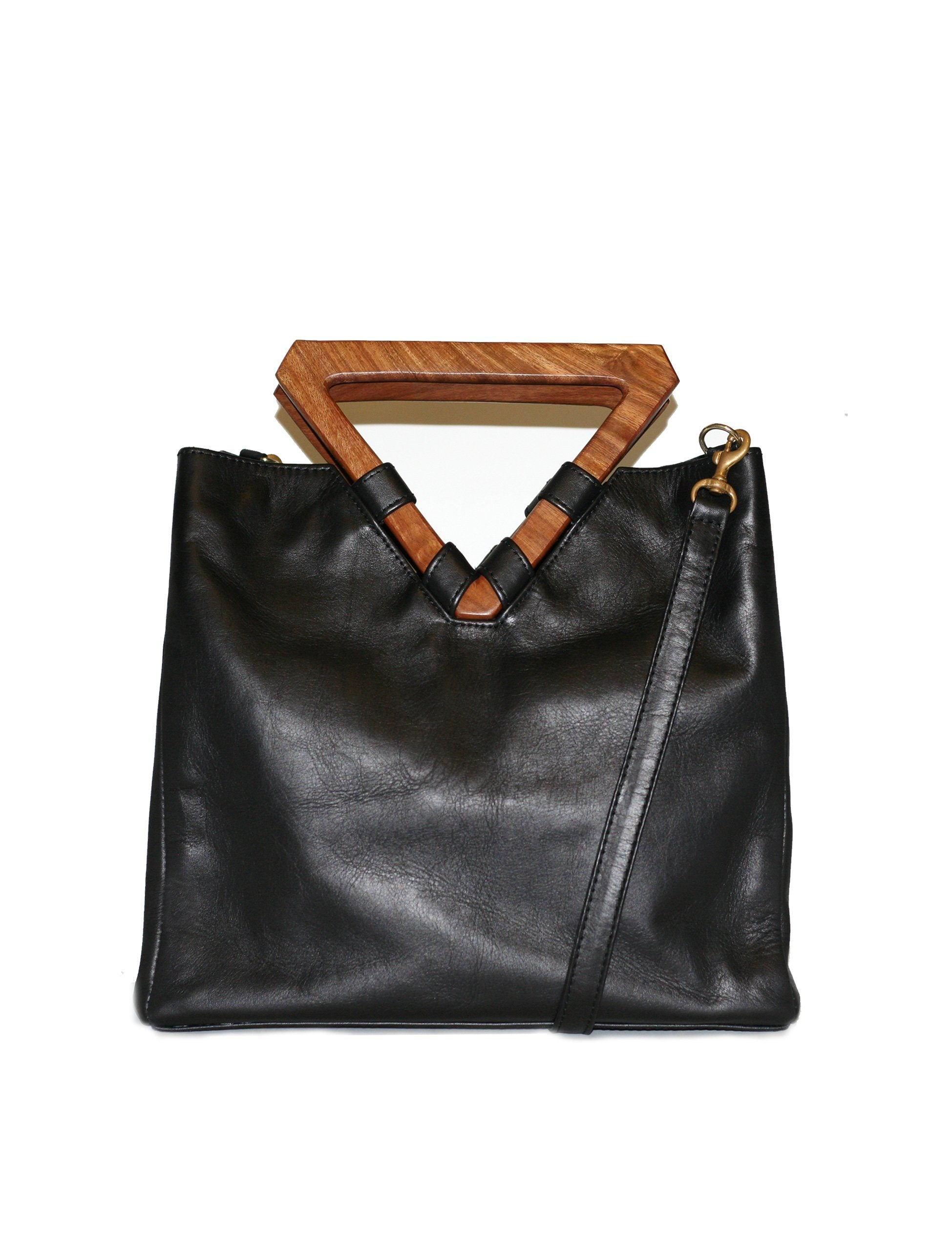 Perfect bag for business and pleasure. Made from leather with wooden geometric top handle. Also includes removable shoulder strap.
