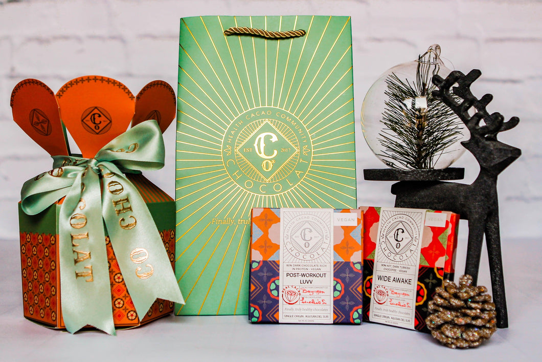 Co Chocolat Carousel Gift Box of Chocolate Bar Duo. 2 Chocolate Bars Assorted flavors (flavors subject to availability)  Packed in a carousel gift box (color of your choice an subject to availability) with ribbon. Comes in small vintage mint paper bag and greeting card.