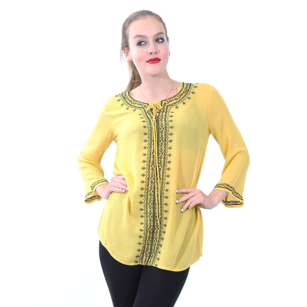 Blusa de manga larga con bordado asimetrico color amarillo