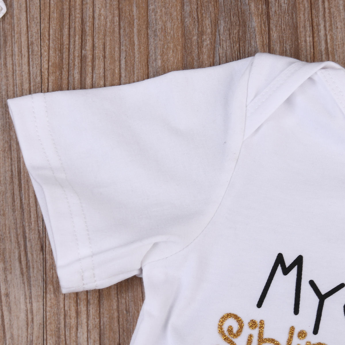 """My Sibling Has Paws"" Onesie baby clothes"