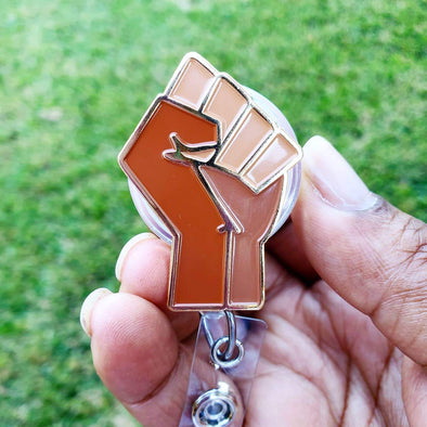 Shades of Us Brown with Gold Accents Power Fist Enamel ID Badge