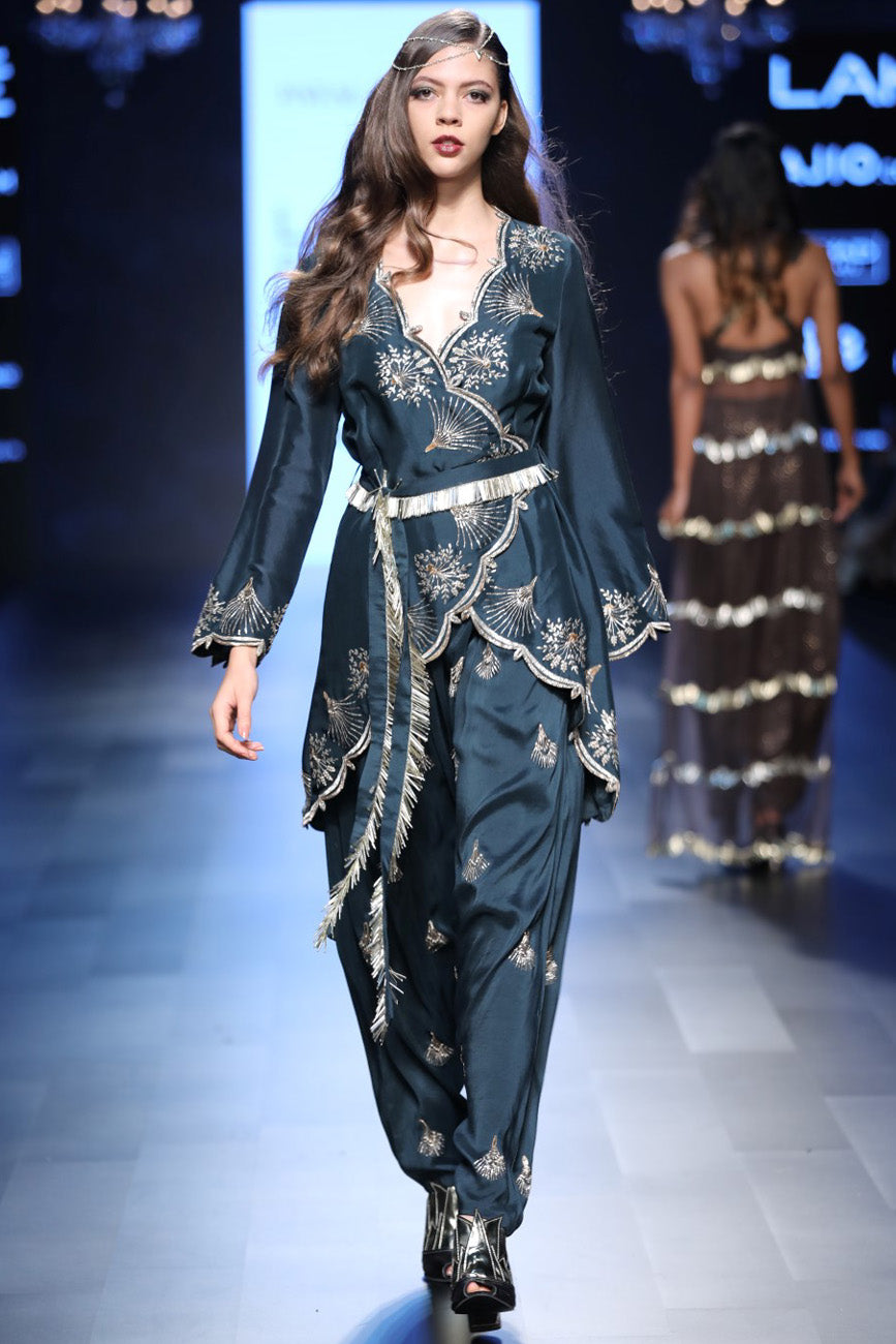 Payal Singhal emerald green embroidered overlap kurta and low crotch pants.