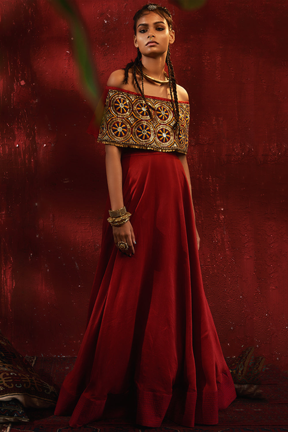 Roshni Chopra red off shoulder embroidered crop top with flared skirt.