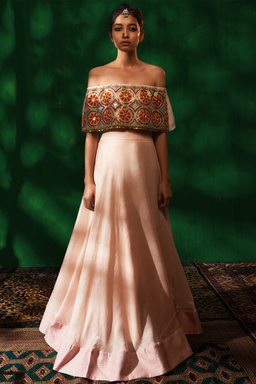 Roshni Chopra pink off shoulder crop top and flared skirt.