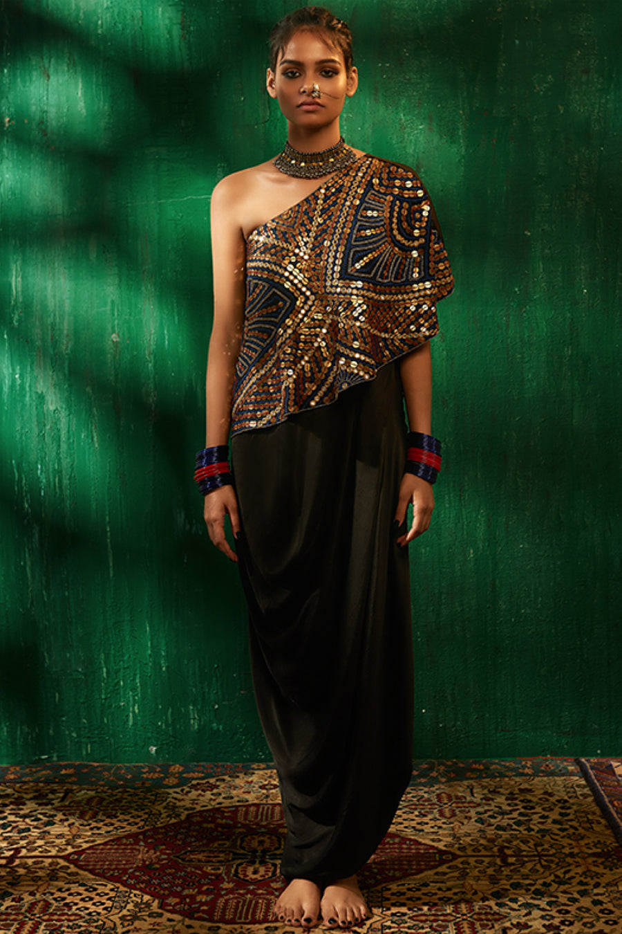 Roshni Chopra black embellished one shoulder top and draped skirt.