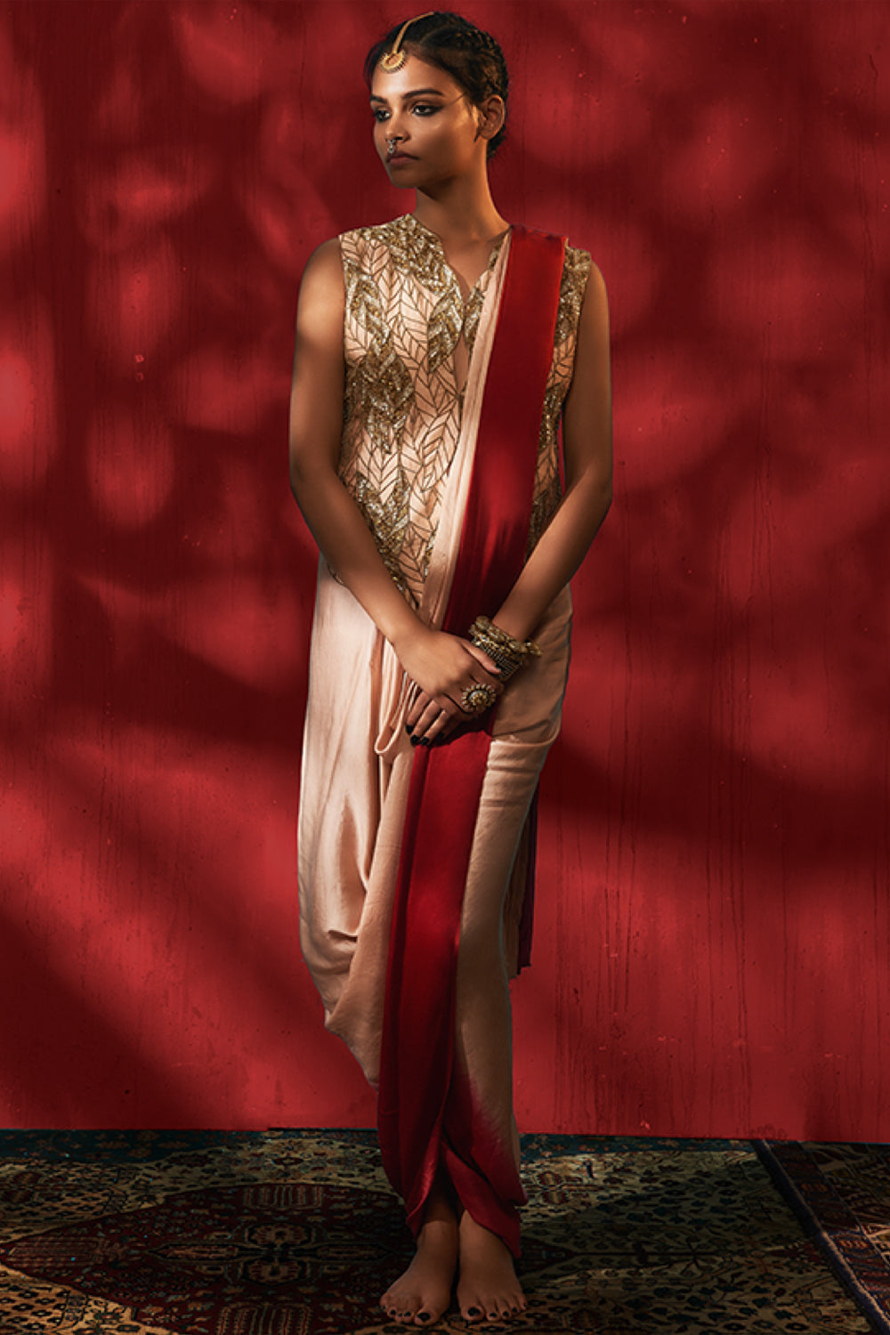 Roshni Chopra pink and red pre draped saree with embellished jacket.