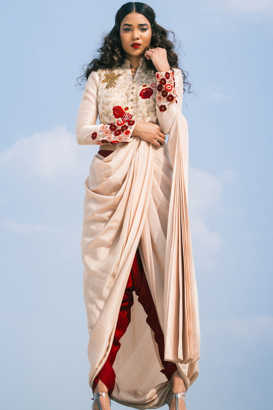 Roshni Chopra peach pre-draped saree with leather detail.