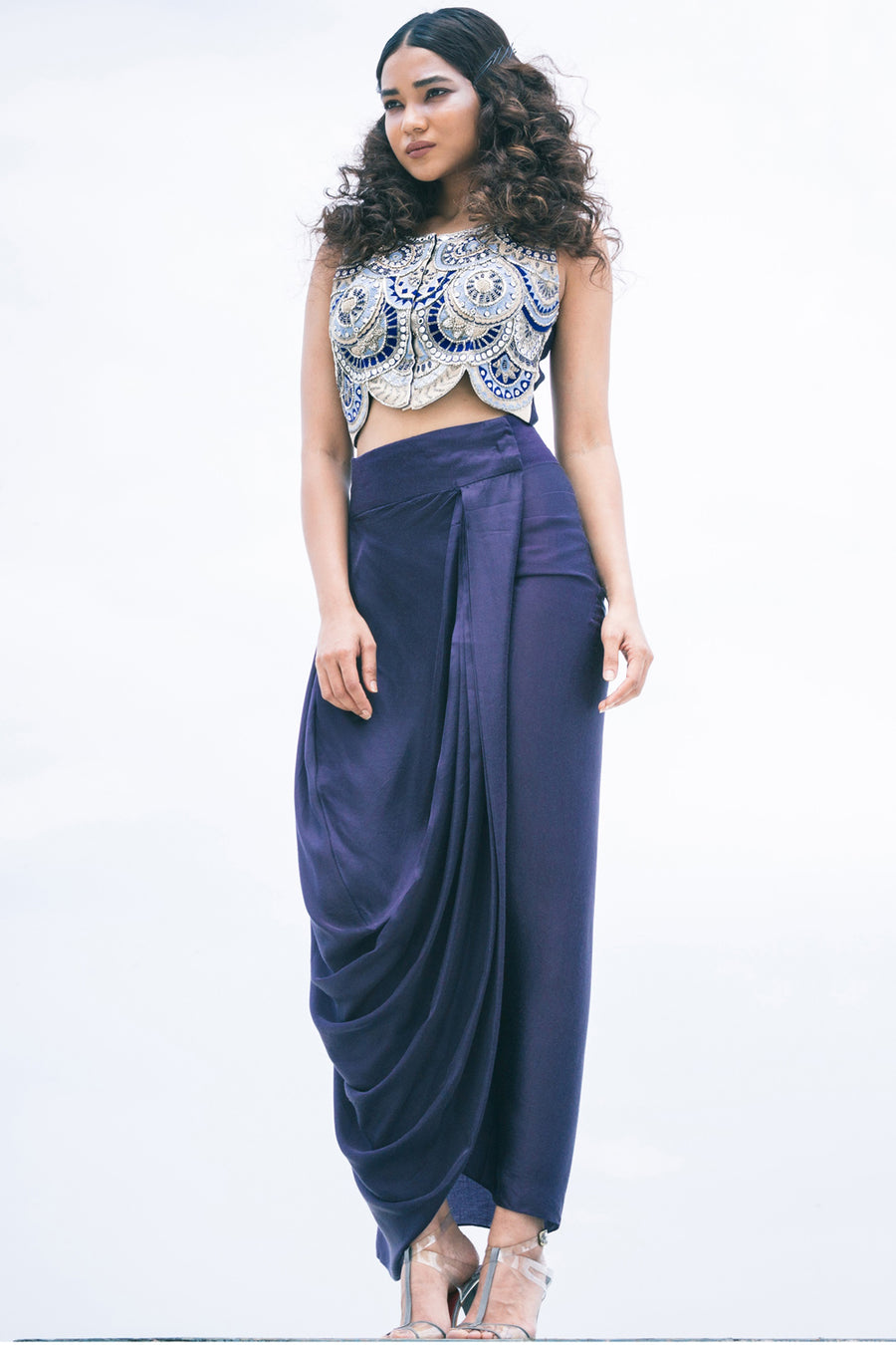 Roshni Chopra blue embroidered crop top and wrap skirt.
