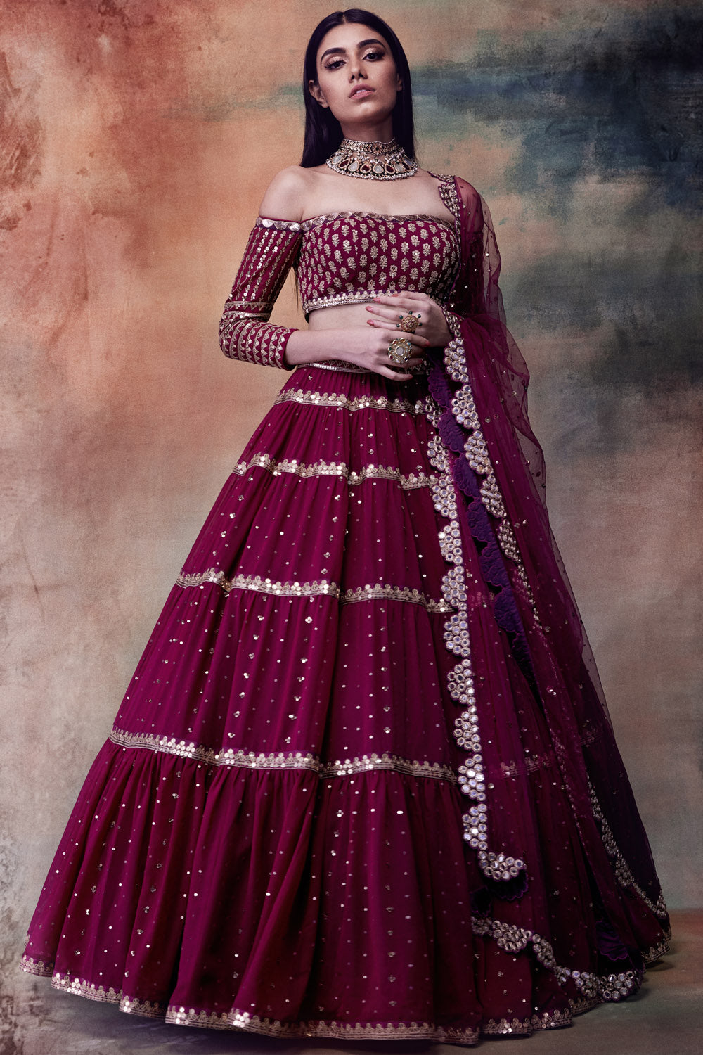 Wine coloured Tiered Lehenga with Off Shoulder Blouse