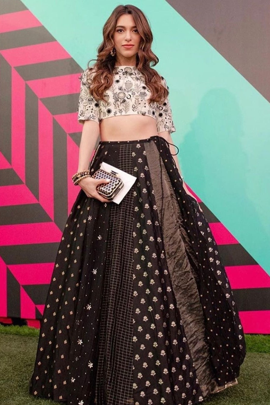 Chalk and black georgette and silk lehenga