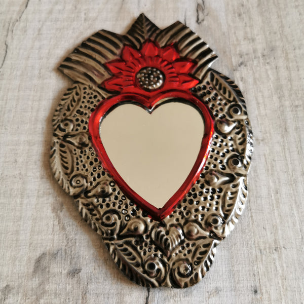 Hand held tin mirror