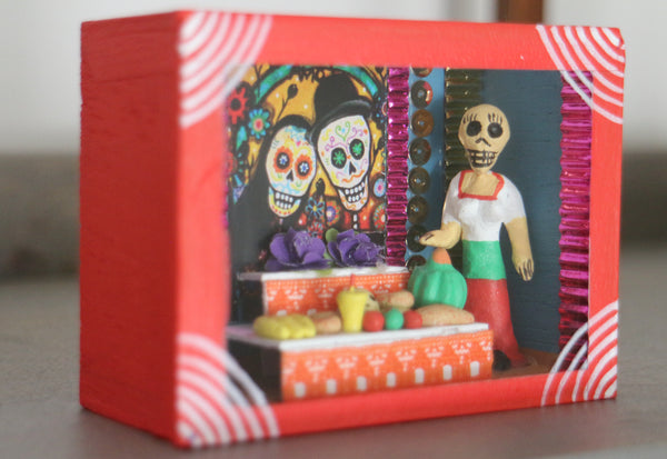 Day of the dead nicho with skeleton altar scene