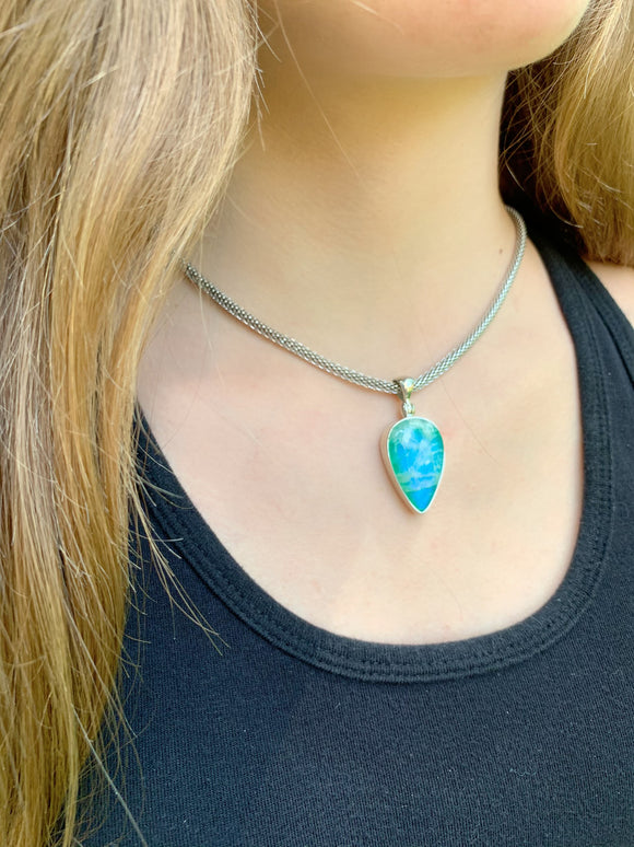 Blue moon stone pendant on a stainless steel weave chain
