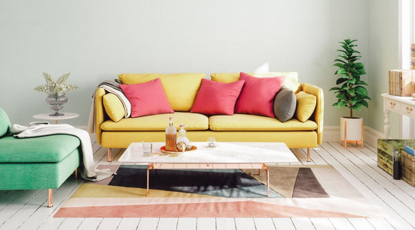 Scandinavian style living room with colorful sofa and accent pillows